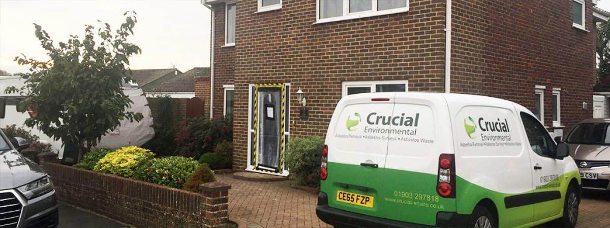 A Crucial Environmental van outside of a house